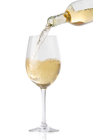 white wine glass: Pouring white wine into a glass, isolated on white background