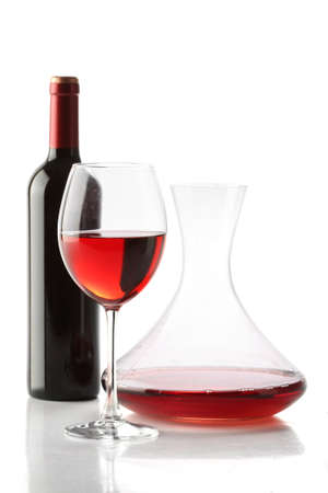 decanter: Red wine. A bottle, a glass and a decanter isolated
