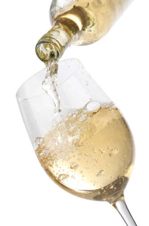 white wine bottle: Pouring white wine into a glass, isolated on white background