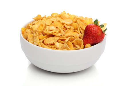 cornflakes: Pile of cornflakes on a bowl over white background Stock Photo
