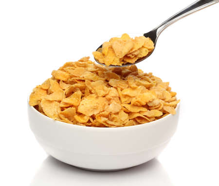 cereal bowl: Cornflakes on a spoon over a bowl
