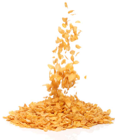 Cornflakes falling into a pile, over white background Stock Photo