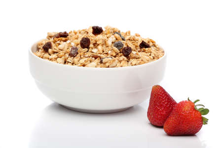 bakground: Granola breakfast on a bowl over white background