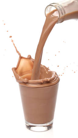 milk drop: Bottle pouring milk chocolate into a glass Stock Photo