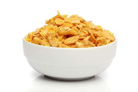 Pile of cornflakes on a bowl over white background Stock Photo