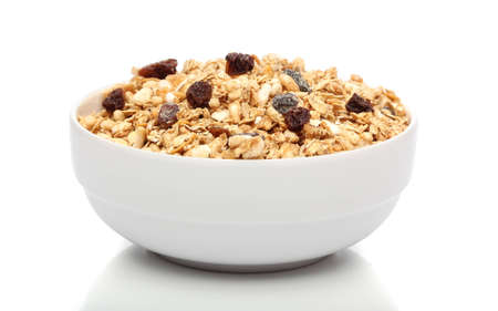 Granola ontbijt op een kom op witte achtergrond Stockfoto