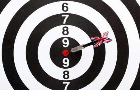 Dartboard bulls eye. Isolated on white background photo