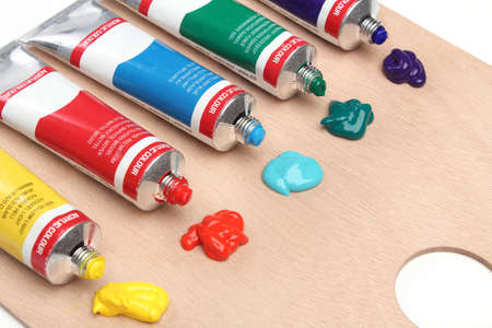 Five paint tubes over a pallete Stock Photo - 13174577