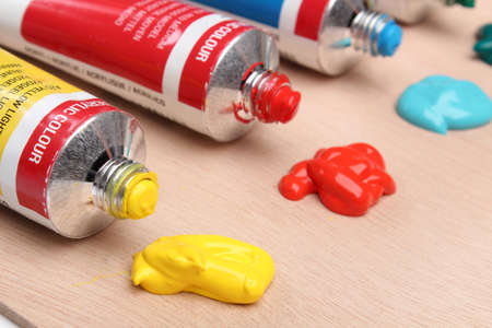 paint tube: Five paint tubes over a pallete