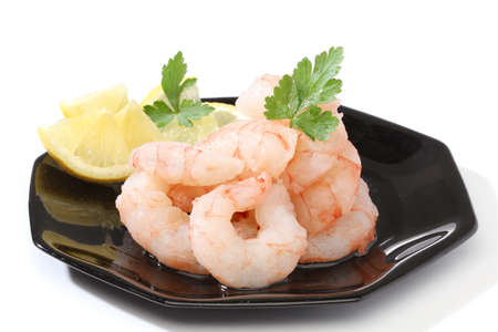 black dish: Pile of prawns over a black dish
