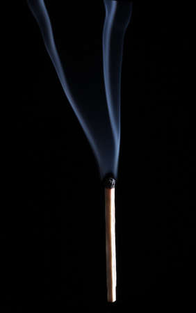 matchstick: Burned match over a black background, with smoke Stock Photo