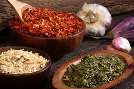 cheff: Various spices over a wood background  Different colours and textures