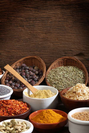 cheff: Various bowls of spices over wooden background  Colours and textures  Stock Photo