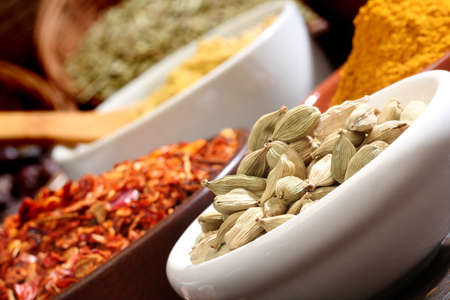 cheff: Close up image of different spices, cinnamon, chili, parsley