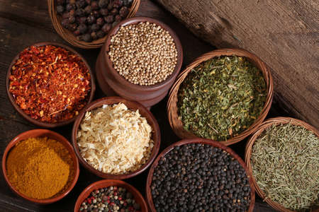 cheff: Different bowls of spices over a wooden background