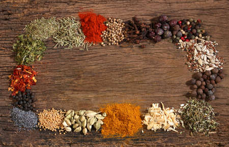 cheff: Different spices over a wooden background  Various colours and textures