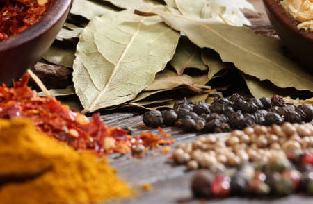 cheff: Different spices over a dark wood  Selective focus