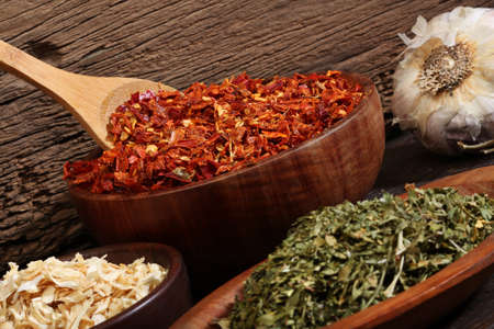 Various spices over a wood background  Different colours and textures  photo
