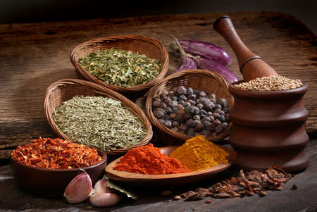 Different spices over a wood background  Various colors and textures  Stock Photo