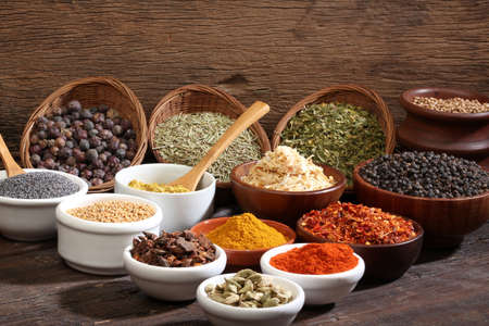 curry spices: Different bowls of spices over a wooden background