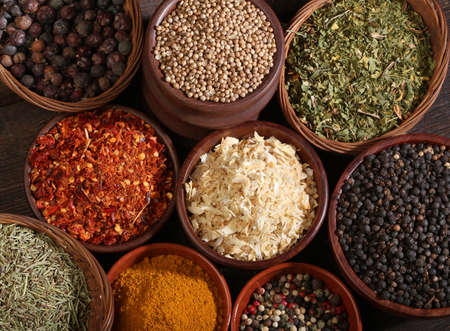 indian spices: Different bowls of spices over a wooden background