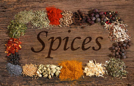 indian mustard: Different spices over a wooden background  Various colours and textures