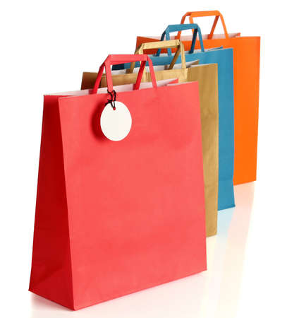 shopping tag: Assorted colored shopping bags over white background