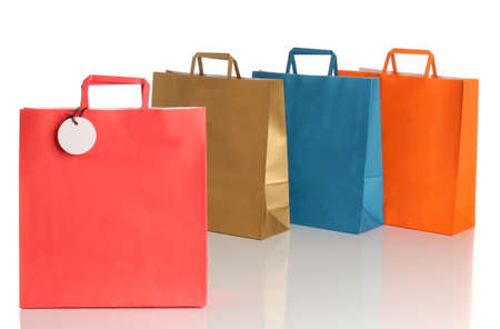 Assorted colored shopping bags over white background photo