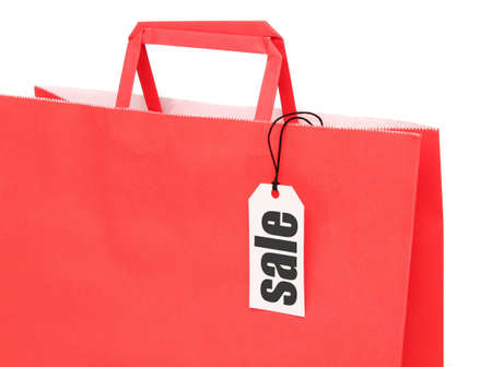 Red paper shopping bag with label over white photo