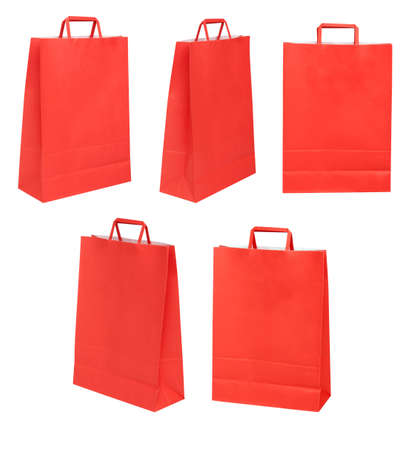 Group of red papers bags on different possitions over white photo