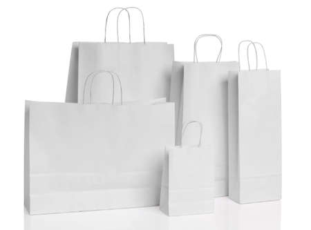 shopping bags: Various paper shopping bags isolated over white background