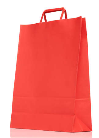 Red paper shopping bag isolated on white background  photo