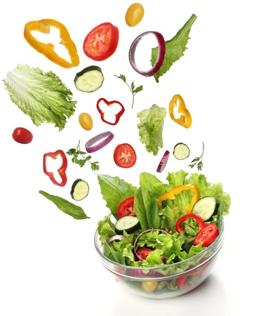 Falling fresh vegetables  Healthy salad isolated