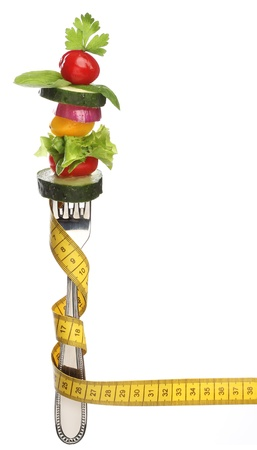 Mixed vegetables on a fork isolated  Diet concept Standard-Bild