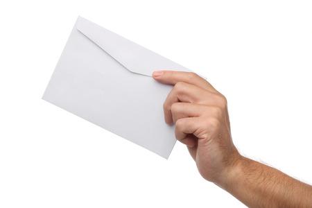 白で隔離白紙の封筒を持っている男性の手 写真素材
