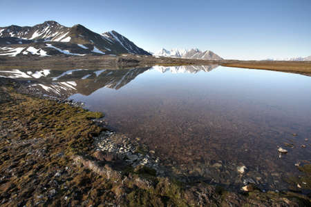alpine tundra: Typical Arctic summer landscape - tundra, water, mountains