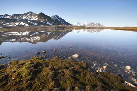 Typical Arctic summer landscape - tundra, water, mountains photo