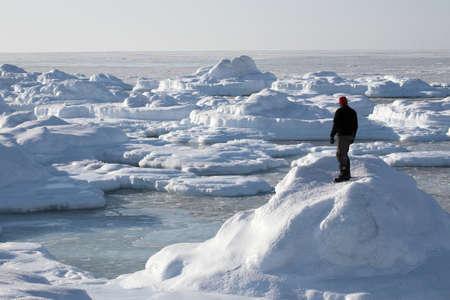 svalbard: Man on the frozen Arctic shore - Spitsbergen, Svalbard