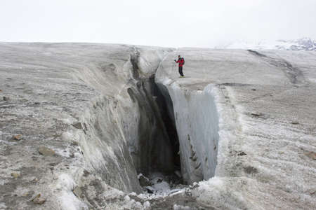 crevasse: Man on the glacier - big glacier crevasse