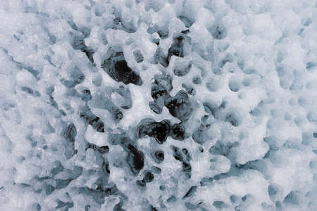 Cryoconite holes are a water filled cylindrical melt-holes on glacial ice surface Stock Photo - 10907675