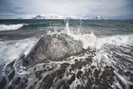 Waves breaking on the shore - Spitsbergen, Svalbard photo
