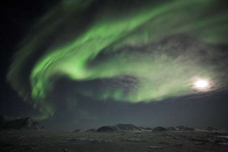 polar station: Northern lights on the Arctic sky