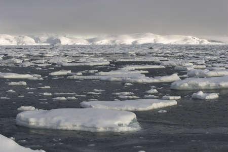 Antarctic winter landscape - ice on the frozen fjord photo