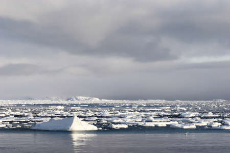 Arctic winter landscape - ice on the frozen fjord photo