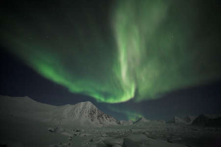 ionosphere: Arctic winter landscape with Northern Lights