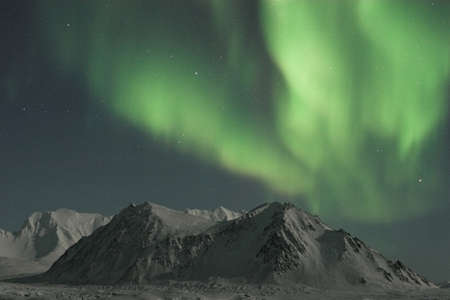 Northern Lights over the Arctic mountains photo