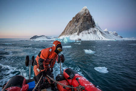 Zodiac cruise in the Arctic fjord - between glaciers, icebergs and mountains