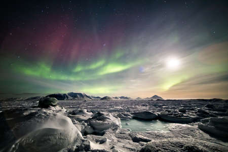 northern lights: Arctic landscape with Northern Lights - Spitsbergen, Svalbard Stock Photo