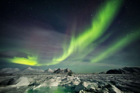 ionosphere: Arctic landscape with Northern Lights - Spitsbergen, Svalbard Stock Photo