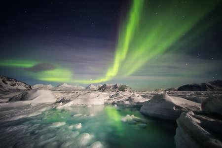 magnetosphere: Arctic landscape with Northern Lights - Spitsbergen, Svalbard Stock Photo
